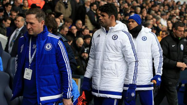 Diego Costa, centre, was among the Chelsea substitutes against Tottenham