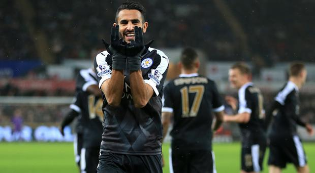 Riyad Mahrez netted a hat-trick at Swansea to put Leicester top of the league