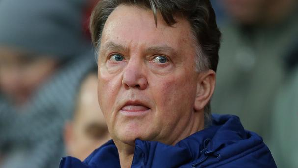 Manchester United fans showed their discontent with manager Louis van Gaal on Saturday