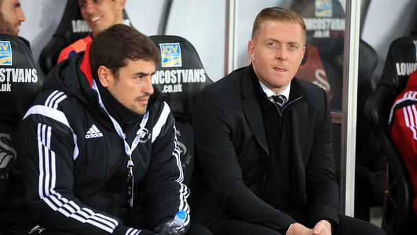 Garry Monk, right, is coming under increasing pressure at Swansea