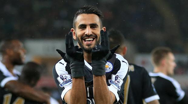 Riyad Mahrez's treble fired Leicester to the top of the table