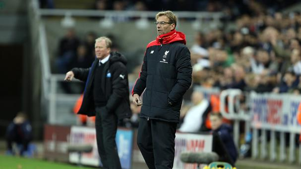 Steve McClaren's, left, Newcastle saw off Jurgen Klopp's, right, Liverpool 2-0
