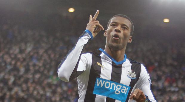 Newcastle match-winner Georginio Wijnaldum celebrates the Magpies' second goal against Liverpool