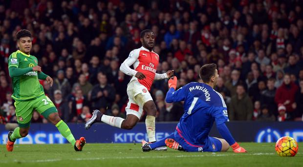 Joel Campbell, centre, is ready to help drive Arsenal onto qualification for the last 16 of the Champions League