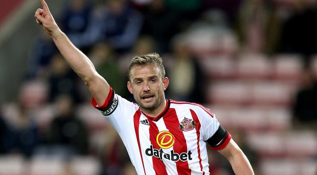 Lee Cattermole is out of Sunderland's clash with Watford on Saturday due to a back injury.