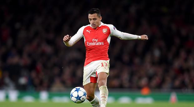 Arsenal boss Arsene Wenger is hopeful Alexis Sanchez, left, could feature against Manchester City