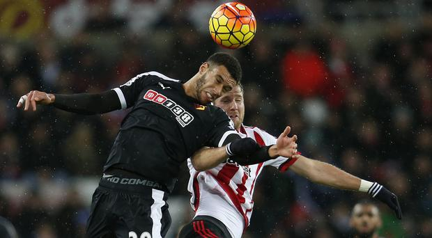 Etienne Capoue, left, and Ola Toivonen battle for the ball at the Stadium of Light