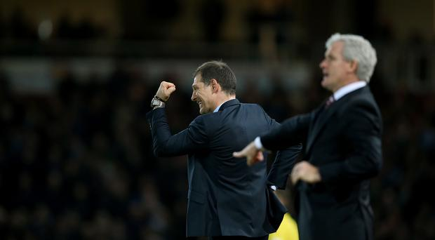 Slaven Bilic, left, and Mark Hughes saw their teams play out an entertaining goalless draw