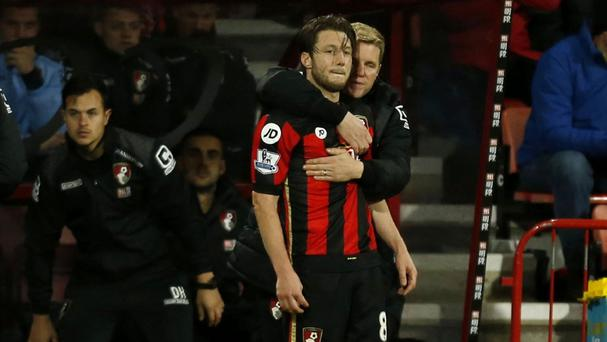 Bournemouth manager Eddie Howe holds midfielder Harry Arter on the touchline