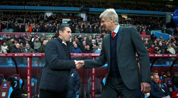 Aston Villa manager Remi Garde, left, watched his side lose for the 12th time of the season against Arsenal on Sunday.