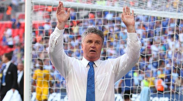 Guus Hiddink, pictured, has told Dutch newspaper De Telegraaf that he is in talks with Chelsea over succeeding Jose Mourinho as manager