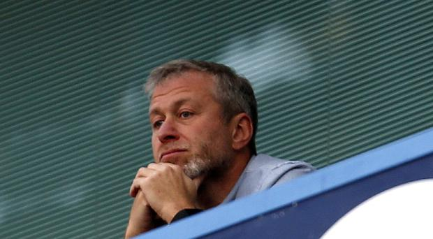 Roman Abramovich, pictured, headed to Chelsea's training ground on Friday as the club stepped up moves to install Guus Hiddink as interim boss