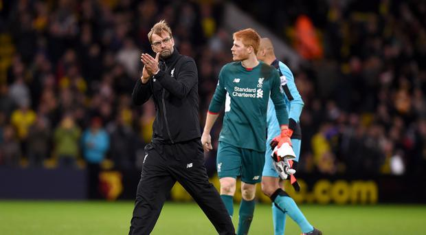 Jurgen Klopp, left, saw his side well beaten at Vicarage Road