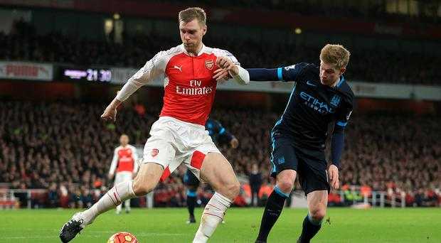 Per Mertesacker, left, believes Arsenal still have more to prove