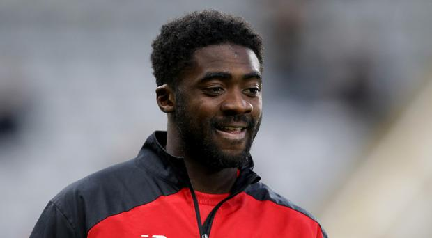 Liverpool defender Kolo Toure is helping orphans in Ivory Coast