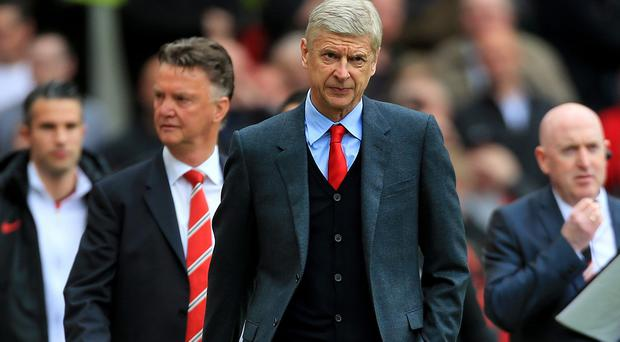 Arsenal boss Arsene Wenger, right, has defended the record of Manchester United counterpart Louis van Gaal, left