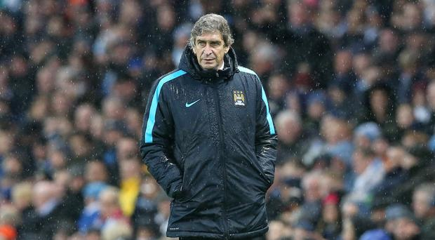 Manchester City manager Manuel Pellegrini, pictured, does not think Pep Guardiola rumours will affect his players