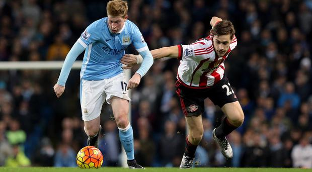 Kevin De Bruyne, left, scored and had two assists against Sunderland