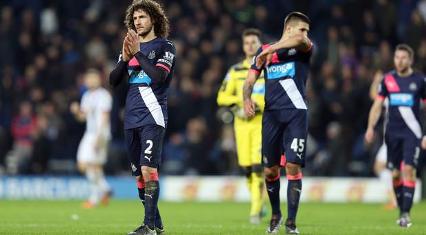 Newcastle's Fabricio Coloccini, left, applauds the travelling fans after their 1-0 defeat at West Brom