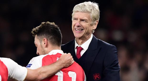 Arsenal manager Arsene Wenger (right) believes Mesut Ozil is developing into a leader in his squad