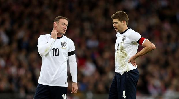 Steven Gerrard, right, thinks Wayne Rooney, left, is still the main man for England