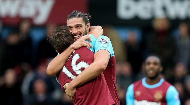 West Ham's Andy Carroll celebrates his goal with a hug from team-mate Mark Noble