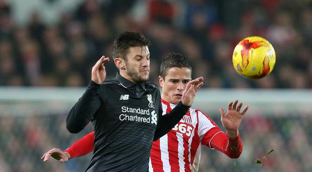 Adam Lallana, left,, insists Jurgen Klopp's training sessions are not to blame for Liverpool's injury crisis