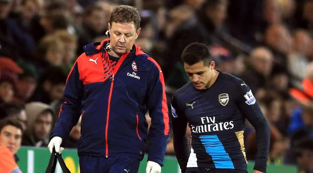 Alexis Sanchez, right, missed Arsenal's entire festive fixture list