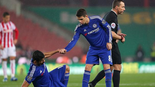 Diego Costa, left, and Oscar exchanged robust challenges on the training ground
