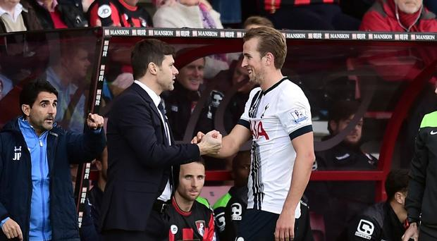Tottenham Hotspur manager Mauricio Pochettino and Harry Kane