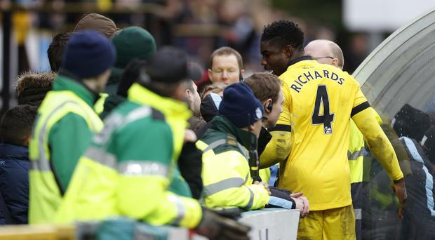 Aston Villa's Micah Richards, right, speaks to furious fans during their 1-1 FA Cup draw at Wycombe