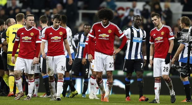 Wayne Rooney, left, scored a brace in Manchester United's 3-3 draw at Newcastle