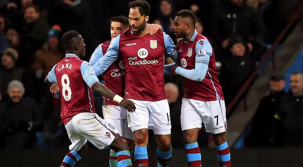 Joleon Lescott, centre, celebrates his winner for Aston Villa at home to Crystal Palace