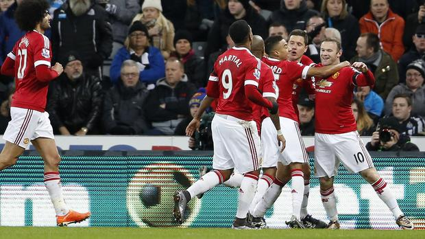 Wayne Rooney, right, scored twice but Manchester United were pegged back by Newcastle