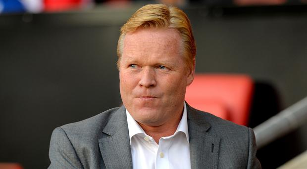 Ronald Koeman, pictured, believes Fraser Forster can make it back in the England team for June
