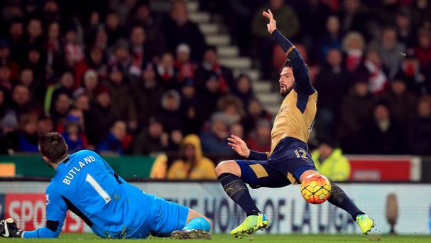 Jack Butland, left, saves from Olivier Giroud at the Britannia Stadium