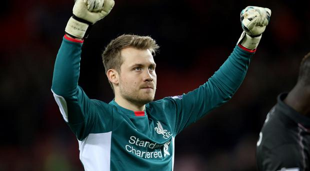 Liverpool goalkeeper Simon Mignolet is celebrating a new five-year contract.