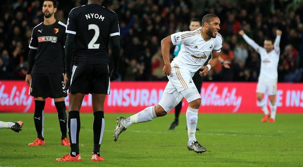 Ashley Williams, right, celebrates scoring for Swansea against Watford
