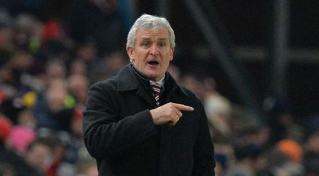 Mark Hughes takes his Stoke side to Leicester on Saturday