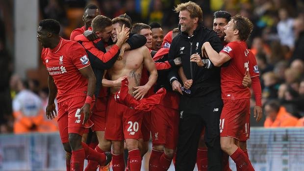 Liverpool celebrate a dramatic 5-4 victory at Norwich