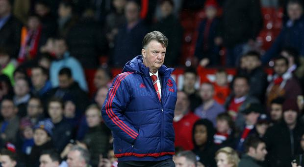 Manchester United manager Louis van Gaal leaves the field dejected after defeat to Southampton