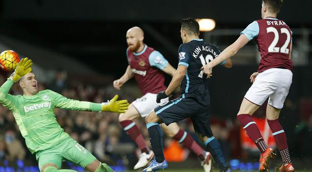 Sergio Aguero, centre, scored twice as Manchester City drew 2-2 at West Ham