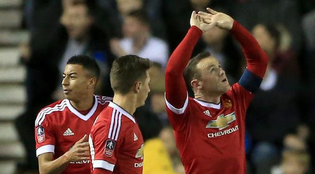 Wayne Rooney, right, celebrates his goal at Derby on Friday