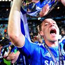 John Terry changed into his full kit to lift the European Cup