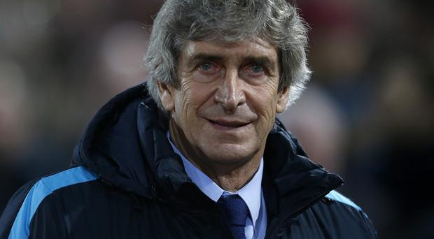 Manuel Pellegrini recognises Manchester City's quest for the quadruple will see the games pile up