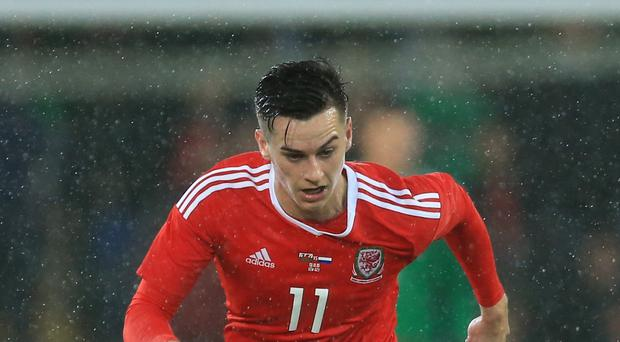Wales striker Tom Lawrence has joined Cardiff on loan from Leicester for the rest of the season.