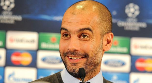 Jurgen Klopp feels Pep Guardiola, pictured, will be out to win it all with Manchester City