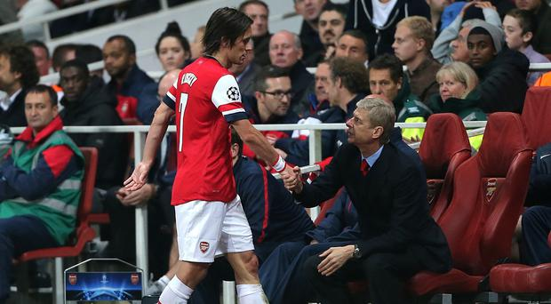 Arsenal's Tomas Rosicky, left, has suffered another setback after a thigh injury at the weekend