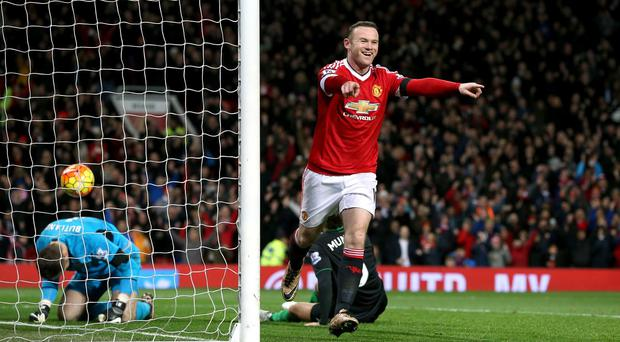 Wayne Rooney celebrates scoring the third goal