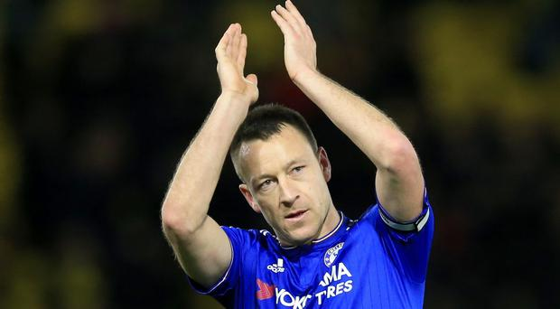Chelsea's John Terry applauds the fans after the Barclays Premier League match at Vicarage Road